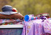 stock photo of woodstock  - Hippie objects over the roof of a van - JPG