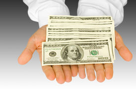 stock photo of holding money  - business concepts - JPG