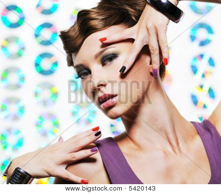Portrait Of Pretty Trendy Young Woman With Hands At Face