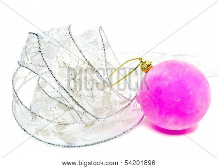 Pink velvety New Year's ball and elegant tinsel on a white background