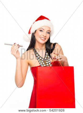 Young and beautiful Christmas shopper girl with the electronic cigarette isolated on white background