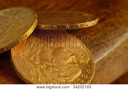 Few swiss golden coins from last century as still life
