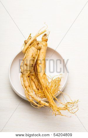Fresh ginseng on the white bowl