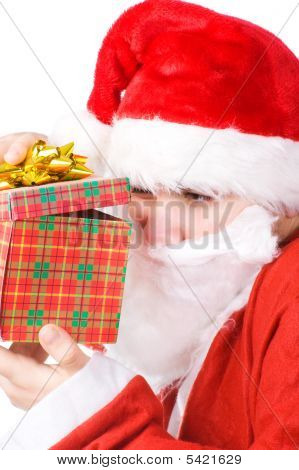 Santa Claus Looking Into Gift Box