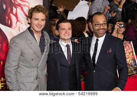 LOS ANGELES, CA - NOVEMBER 18: Actors Sam Claflin, Josh Hucherson and Jeffery Wright attend the premiere of The Hunger Games: Catching Fire at the Nokia Theater in Los Angeles, CA on November 18, 2013