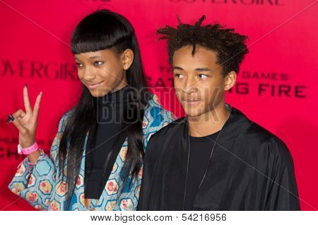 LOS ANGELES, CA - NOVEMBER 18: Actors Jaden Smith and Willow Smith arrive at the premiere of The Hunger Games: Catching Fire at the Nokia Theater in Los Angeles, CA on November 18, 2013