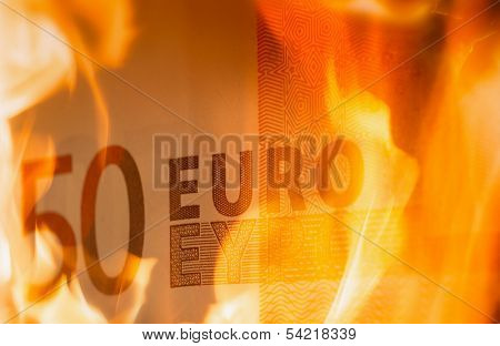 euro banknotes burning