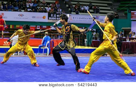 KUALA LUMPUR - NOV 05: Members of Singapore's dalian team performs a fight scene in the Men's Dual Event at the 12th World Wushu Championship on November 05, 2013 in Kuala Lumpur, Malaysia.