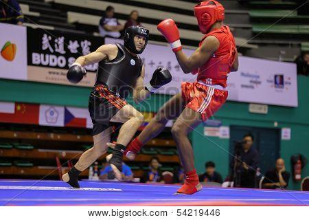 KUALA LUMPUR - NOV 03: France's Jason Ponet (red) fights USA's Alejandro Cisne (black) in the 'Sanda' event of the 12th World Wushu Championship on November 03, 2013 in Kuala Lumpur, Malaysia.