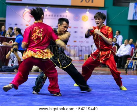 KUALA LUMPUR - NOV 05: Members of Malaysia's dalian team performs a fight scene in the Men's Dual Event at the 12th World Wushu Championship on November 05, 2013 in Kuala Lumpur, Malaysia.