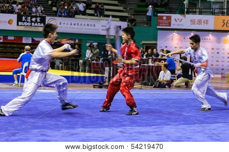 KUALA LUMPUR - NOV 05: Members of Philippine's dalian team performs a fight scene in the Men's Dual Event at the 12th World Wushu Championship on November 05, 2013 in Kuala Lumpur, Malaysia.