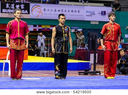 KUALA LUMPUR - NOV 05: Members of Malaysia's dalian team enters the ring for the Men's Dual Event at the 12th World Wushu Championship on November 05, 2013 in Kuala Lumpur, Malaysia.