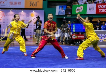 KUALA LUMPUR - NOV 05: Members of Macau's dalian team performs a fight scene in the Women's Dual Event at the 12th World Wushu Championship on November 05, 2013 in Kuala Lumpur, Malaysia.