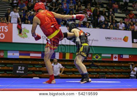 KUALA LUMPUR - NOV 05: Russia's Bektermirov Arslan (black) fights Iran's Hamidreza Gholipour in the Sanda boxing event, 12th World Wushu Championship on November 05, 2013 in Kuala Lumpur, Malaysia.