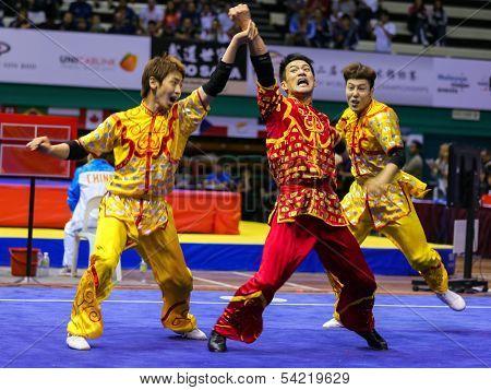 KUALA LUMPUR - NOV 05: South Korea's dalian team performs a fight scene in the Men's Dual Event at the 12th World Wushu Championship on November 05, 2013 in Kuala Lumpur, Malaysia.
