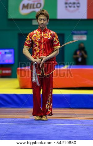 KUALA LUMPUR - NOV 03: South Korea's Jo Kyeyong performs with a sword in the Men's 'Daoshu' Event at the 12th World Wushu Championship on November 03, 2013 in Kuala Lumpur, Malaysia.