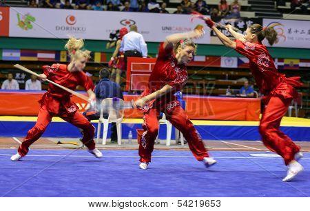 KUALA LUMPUR - NOV 05: Members of Ukraine's dalian team performs a fight scene in the Women's Dual Event at the 12th World Wushu Championship on November 05, 2013 in Kuala Lumpur, Malaysia.