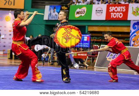 KUALA LUMPUR - NOV 05: France's dalian team performs a fight scene in the Men's Dual Event at the 12th World Wushu Championship on November 05, 2013 in Kuala Lumpur, Malaysia.