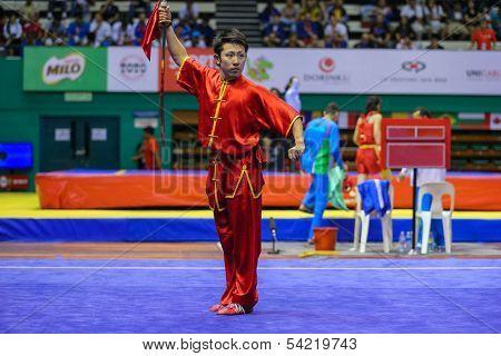 KUALA LUMPUR - NOV 03: Japan's Ryosuke Kishi performs with a sword in the Men's 'Daoshu' Event at the 12th World Wushu Championship on November 03, 2013 in Kuala Lumpur, Malaysia.