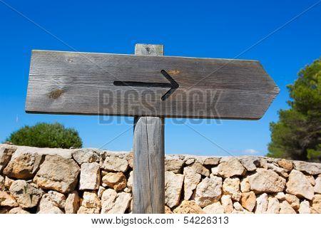 Arrow wooden track blank road sign in Mediterranean Balearic islands