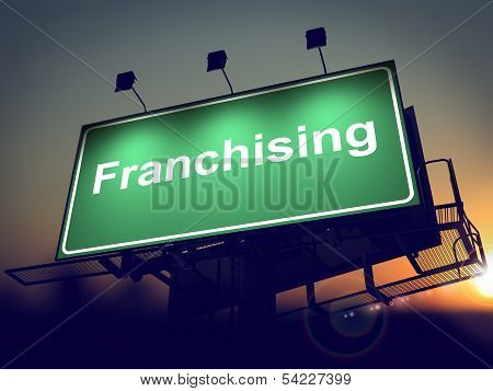 Franchising - Billboard on the Sunrise Background.