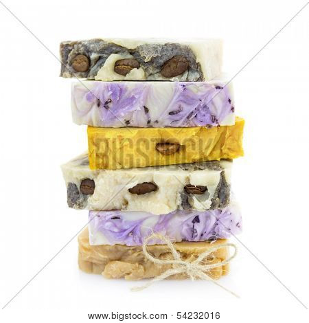 Pile of handmade natural colorful soap on white background