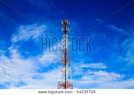 Telecom Tower  And Cloudy Blue Sky