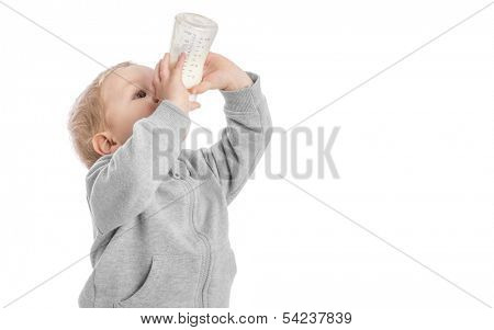 Little boy drinking milk from bottle
