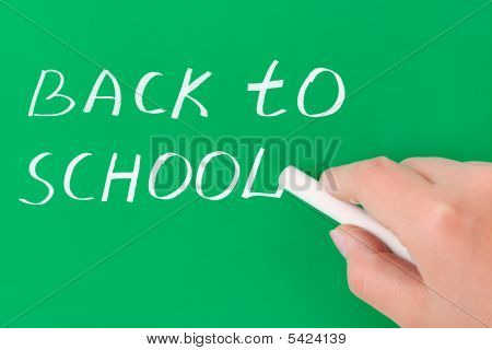 Hand With Chalk Writing Back To School