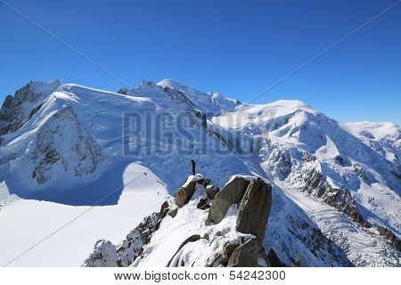 Unidentified climbers instructor at the mountain top station of the Aiguille du Midi in French Alps