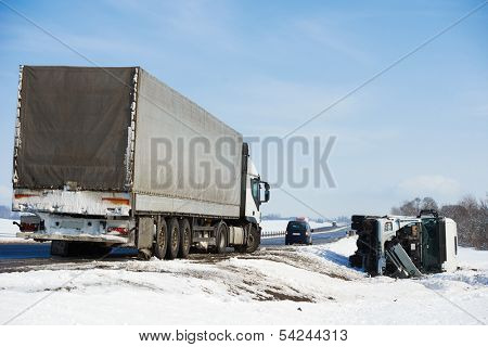 Lorry trailer car crash smash accident on an slippery winter snow interstate road