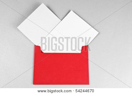 Two cards in red envelope