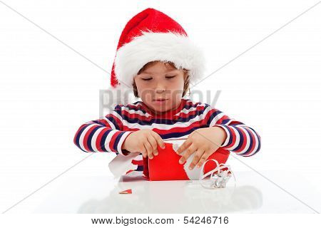 Little Boy Unpacking Gift