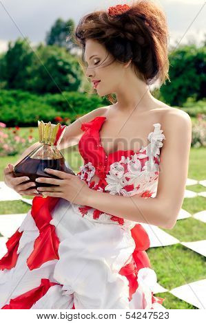 Chess Queen Holds A Large Bottle Of Perfume