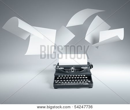 Old Type Writer With Paper Sheets Flying