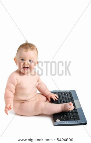 Happy Chubby Baby Playing With Computer Keyboard Isolated On White With Shadow. Copy Space And Room