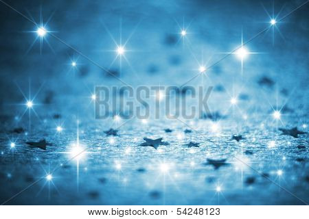 Blue winter background with stars