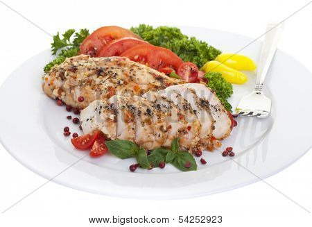 Spicy chicken breasts served on a plate with a white background.
