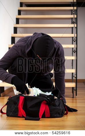 Thief Packing The Stolen Money