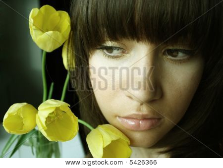 Young Charming Woman With Bouquet Of Tulips