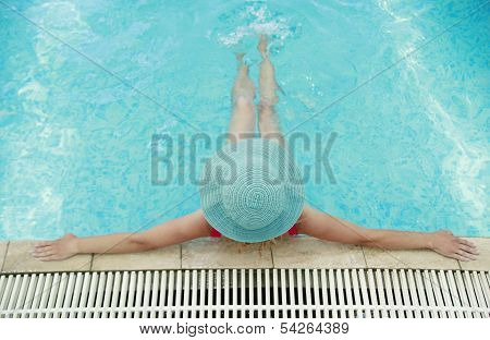 Young Girl With Hat In Water Pool
