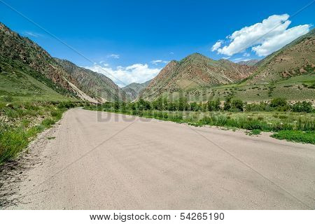Wide country road in mountains