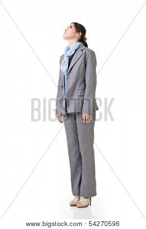 One business executive look up, full length portrait isolated on white background.