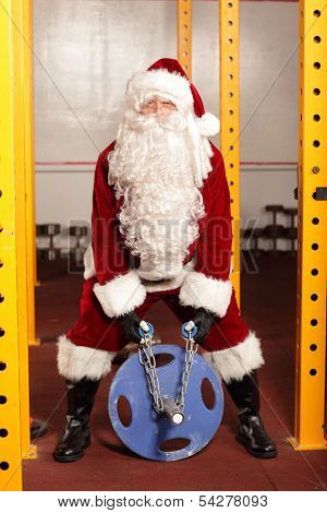 Santa Claus  training before Christmas time in gym
