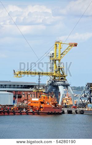 Bunker ship (fuel replenishment tanker) under port crane