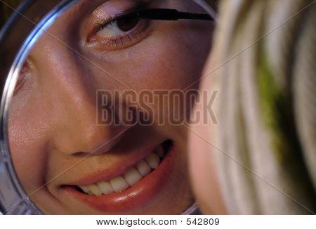 Beautiful Woman Making Make Up