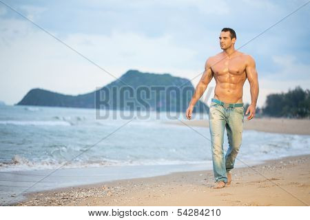 Strong young man portrait at the beach