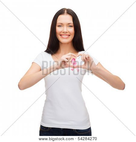 healthcare and medicine concept - smiling woman in blank white t-shirt with pink breast cancer awareness ribbon showing heart shape
