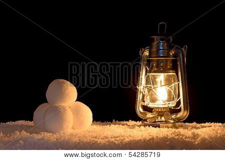 Snowballs illuminated by the light of an oil filled lamp