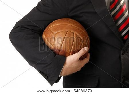 Business man is holding ball for soccer or football